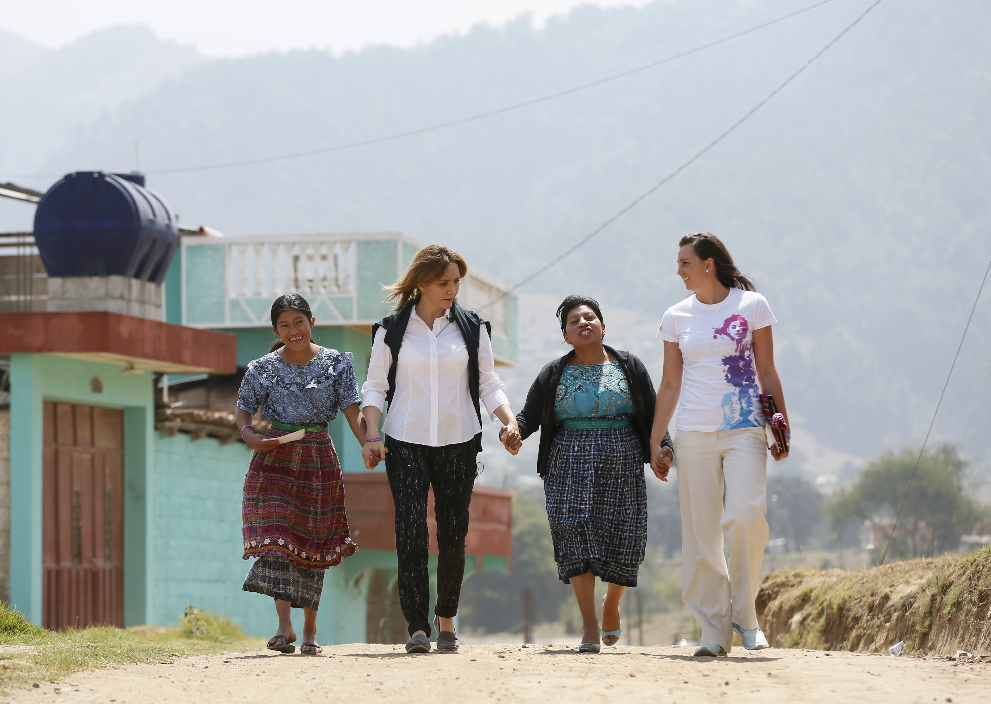 Angelica Fuentes, CEO of Omnilife and Founder of Angelissima, second left, and Olympic gold medalist, Rebecca Soni, right, share experiences with girls from Paxtoca during a visit from Girl Up, a campaign of the United Nations Foundation, during a trip to Guatemala, to learn more about UN programs that help adolescent girls receive an education, see a doctor, and stay safe from violence, Guatemala, April 18, 2013. (INSIDER IMAGES/Stuart Ramson for UN Foundation)
