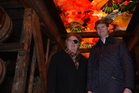 """Maker's Mark Chief Operating Officer, Rob Samuels (right), and artist, Dale Chihuly (left) beneath """"The Spirit of the Maker"""" at the Maker's Mark Distillery. (Photo: Business Wire)"""