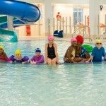Kids take a dip in the family pool in the brand new Rockaway YMCA at Arverne by the Sea - just one of 19 YMCA locations offering free basic water safety and swim programs during YSplash Week. (Photo: Business Wire)