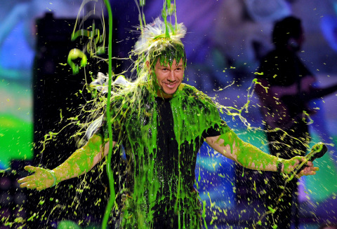 Host Mark Wahlberg gets slimed at Nickelodeon's 27th Annual Kids' Choice Awards, March 29, 2014, at  ...