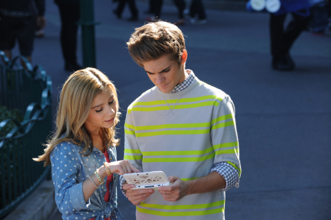 In this photo provided by Nintendo of America, actor G Hannelius, currently starring in the Disney Channel sitcom Dog With A Blog , films a promo for the new Disney Magical World game with actor Cole Pendery at the Downtown Disney® District last month. Disney Magical World launches exclusively for the Nintendo 3DS family of systems on April 11. Cole is holding the new Mickey Edition Nintendo 3DS XL system that will be available at Wal-Mart. (Photo: Business Wire)