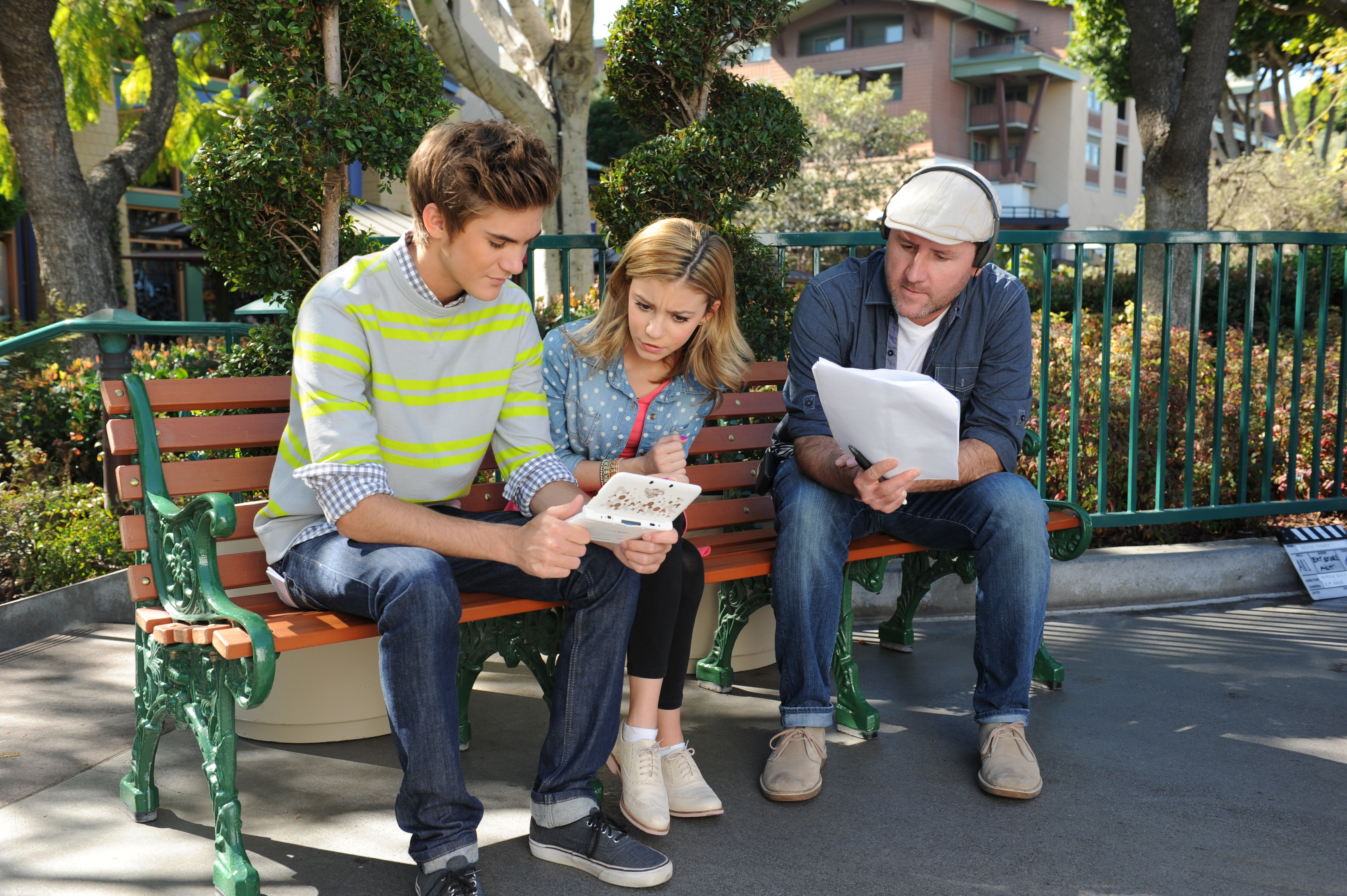In this photo provided by Nintendo of America, actor G Hannelius, currently starring in the Disney Channel sitcom Dog With A Blog, reviews the script with actor Cole Pendery and director Patrick Kiely while on set for a Disney Magical World promo shoot at the Downtown Disney® District last month. Launching exclusively for the Nintendo 3DS family of systems on April 11, Disney Magical World allows players to interact with more than 60 Disney characters and visit exciting Disney-themed worlds. (Photo: Business Wire)