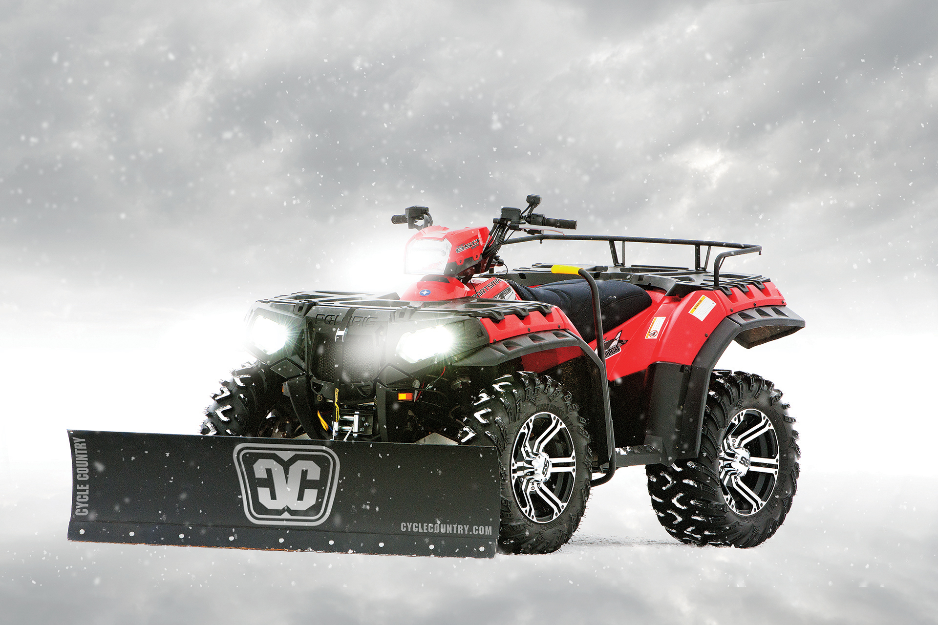 A Polaris Sportsman with a Cycle Country straight steel blade accessory. Today, Polaris Industries Inc. announced it has acquired Kolpin Outdoors, Inc. (Photo: Business Wire)