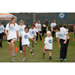 Young challenged athletes learn how to run on their new running legs provided by CAF grants. (Photo: Business Wire)