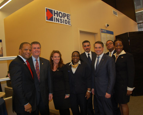 Pictured left to right front row: John Hope Bryant, Founder, Chairman and CEO, Operation HOPE, Inc.; ...