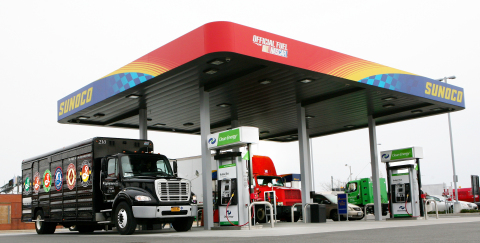 Natural gas vehicles fueling at new public-access Clean Energy Compressed Natural Gas (CNG) station  ...