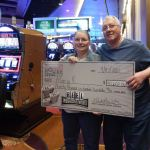 Reel Progressive Payout winner Mary K. and her husband, Charles, pictured with their winnings at SugarHouse Casino. (Photo: Business Wire)