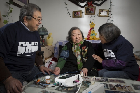 Elderly people who live in the Tang Qiao Community of the Pudong new district of Shanghai receive ho ...