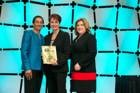 Linda Boykin, Vice President of Contract Merchandising for Office Depot, Inc., accepts an award for America's Top Corporations for Women's Business Enterprises from Benita Fortner, Director of Supplier Diversity for Raytheon Company and Chair of the WBENC Board of Directors, and Pamela Prince-Eason, WBENC President and CEO, at the WBENC Summit & Salute Conference (Photo Credit: Kathy Anderson Photography)