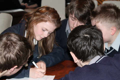 Mulroy College students (left to right): Shane Flood, Aine Green, Caolan Mc Laughlin, Shane Kerr and Connor Dougan, participate in a table quiz at Pramerica Systems Ireland. (Photo: Business Wire)