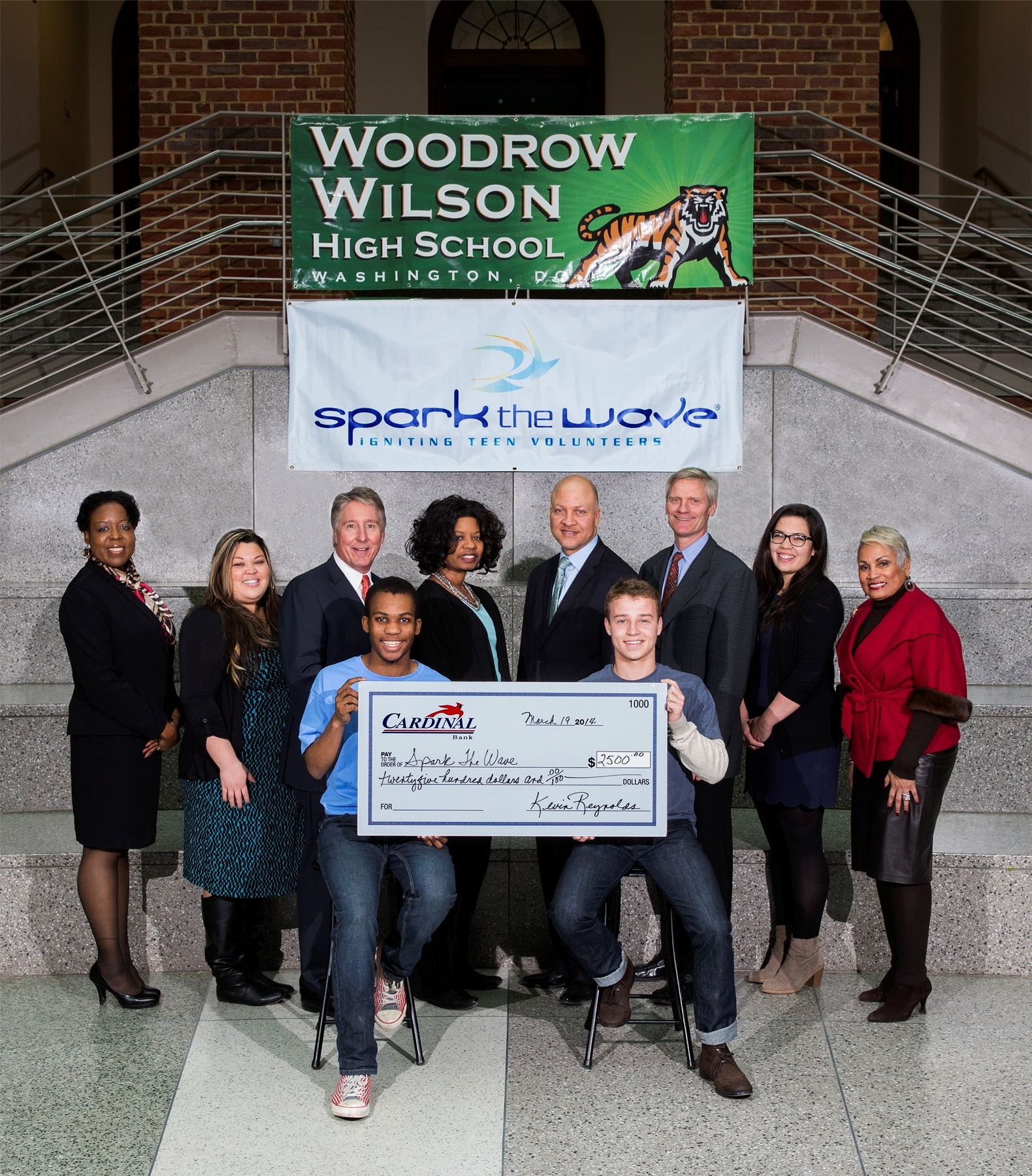 (L-R): Cardinal Banking Office Manager Charlene Davis; Woodrow Wilson High School After School Program Coordinator, Sheilla Hara; Cardinal Bank Regional President Kevin Reynolds; Woodrow Wilson High School Librarian, Pamela Lipscomb-Gardner; Woodrow Wilson Assistant Principal, Gregory Bargeman; Spark the Wave President and Founder, Bill Gallagher; Spark the Wave Director of Wave Week and Recruitment, Laura Payne; former DC Chamber of Commerce president and CEO, Barbara Lang, with students from Woodrow Wilson High School. (Photo: Galen Photography)