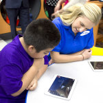 Samsung employee Brittney Pistor, right, interacts with a youth in the Tween Tech Center at Boys & Girls Clubs of Greater Fort Worth on Friday, April 4, 2014. The center is part of a partnership between Samsung Mobile and Boys & Girls Clubs of America to inspire kids' curiosity in STEM. Samsung is creating up to 20 Tween Tech Centers and providing 1200 tablets with custom curriculum applications to select  Boys & Girls Clubs across the country. (Photo: Business Wire)