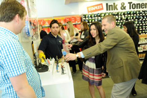 Media, customers and representatives from Staples and 3D Systems checking out 3D printed products at Staples' New York City store launch event. (Photo: Business Wire)