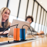 Four times smaller and six times lighter than today's laptop adapters, the FINsix Dart is a full-powered 65W AC adapter that also features a built-in 2.1 amp USB port for simultaneously charging phones and tablets. (Photo: Business Wire)