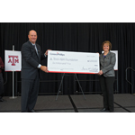 ConocoPhillips Chairman and Chief Executive Officer Ryan Lance presents a $6 million check to Dr. M. Katherine Banks, vice chancellor and dean of engineering at Texas A&M University. The check will support construction of the new Engineering Education C