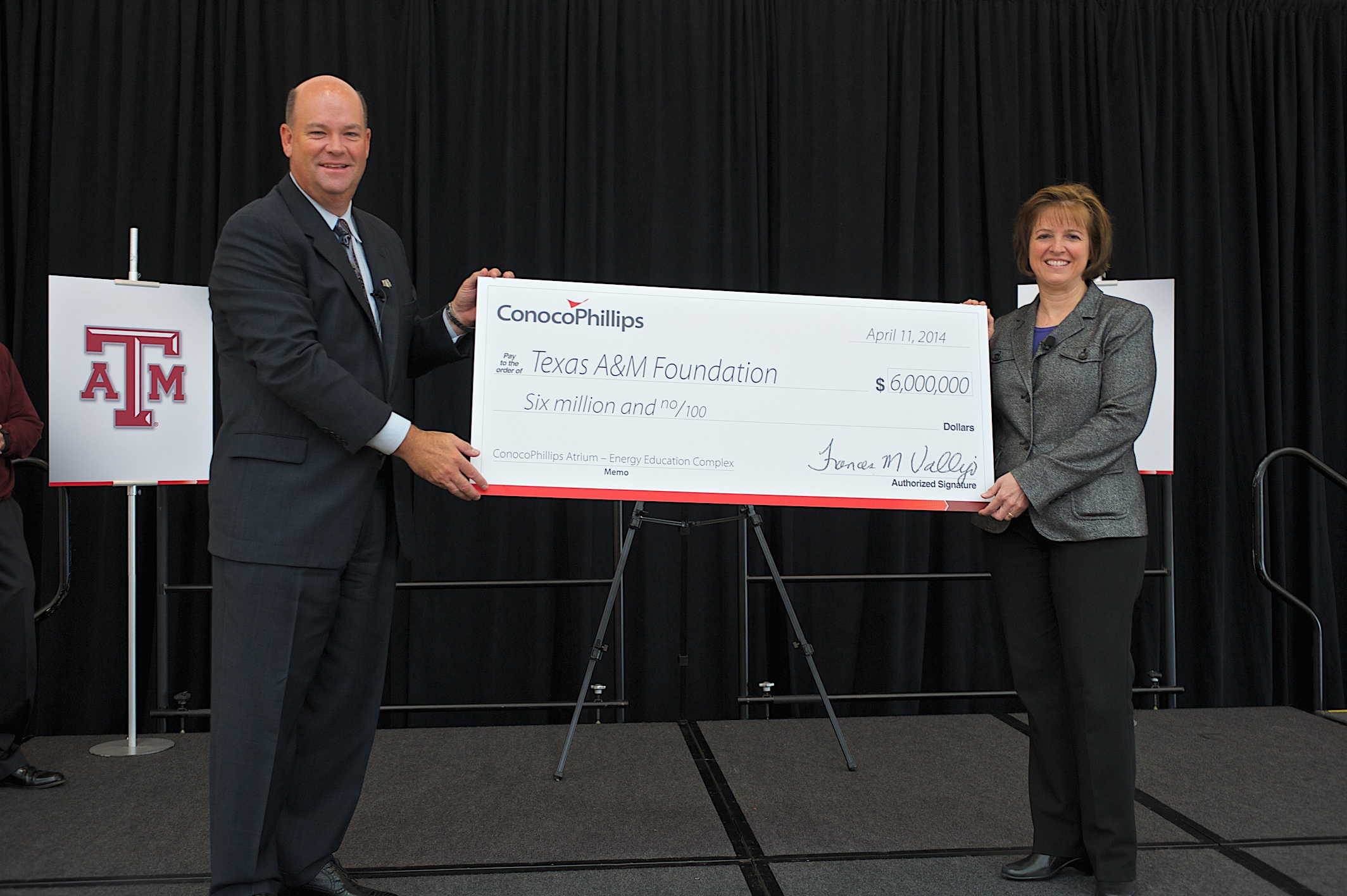 ConocoPhillips Chairman and Chief Executive Officer Ryan Lance presents a $6 million check to Dr. M. Katherine Banks, vice chancellor and dean of engineering at Texas A&M University. The check will support construction of the new Engineering Education Complex. (Photo: Business Wire)