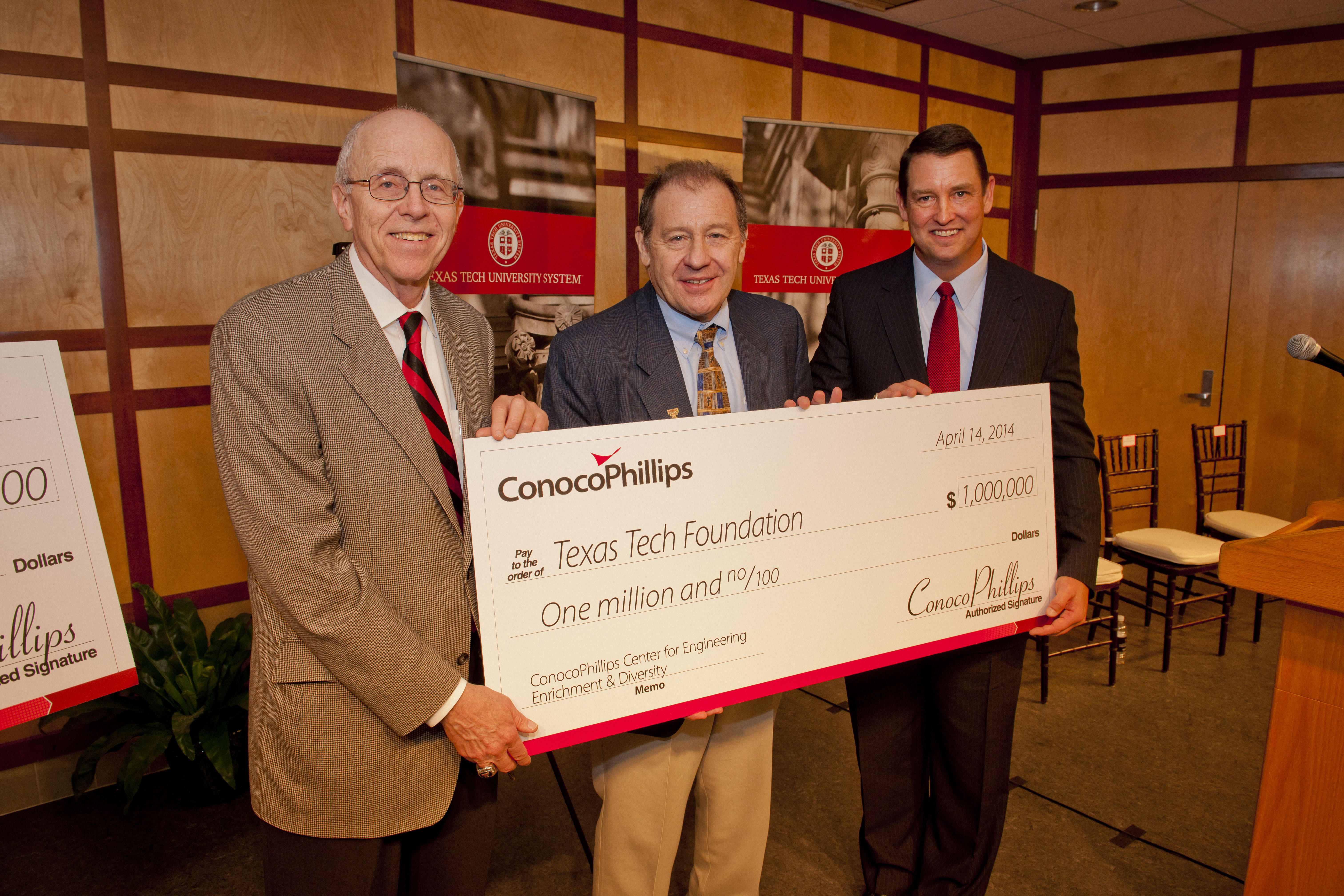 Texas Tech Chancellor Kent Hance and Dean of Engineering Al Sacco accept a $1 million check from Tom Mathiasmeier, ConocoPhillips president, North America Gas & Power. (Photo: Business Wire)