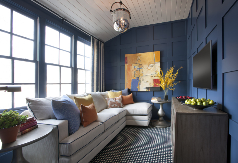 Bathed in blue, the upstairs gathering space offers a spot to relax, watch television, and play games. Photo (c) 2014 Scripps Networks, LLC.