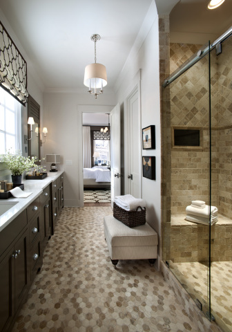 Sophisticated and serene, the master bathroom shines with chrome hardware, a latte color scheme and high-tech features. Photo (c) 2014 Scripps Networks, LLC.