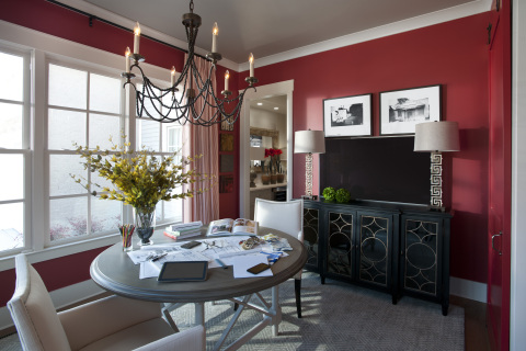 The vibrant dining room doubles as a work space, showcasing electric red, an abundance of natural light and a modern take on a sliding barn door. Photo (c) 2014 Scripps Networks, LLC.
