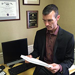 David Howe reviews a report in his office at MCTV (Photo: Business Wire)