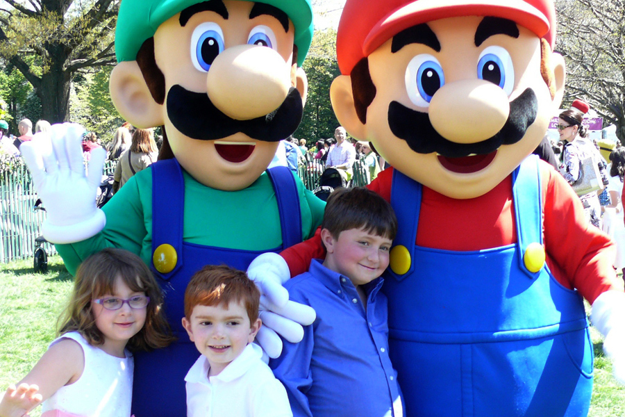In this photo provided by Nintendo of America, Mario and Luigi meet fans Nicholas K., Allison K. and Daniel K. from Piedmont, Calif., during the 136th annual White House Easter Egg Roll on April 21, 2014, in President's Park (one of America's 401 national parks!) Nintendo joined with the National Park Foundation to offer guests the opportunity to take photos with the beloved characters and play Wii Fit U and Wii Sports Club, two games that ask players to get up and get active with Wii U, Nintendo's HD home console. (Photo: Business Wire)
