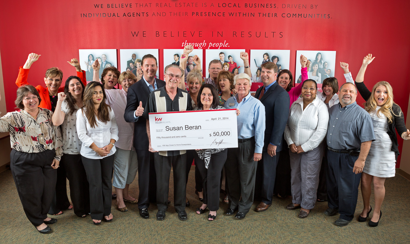 "Kindergarten teacher Susan Beran is congratulated on winning the $50,000 ""Closer to Home"" sweepstakes by associates with the Keller Williams New Tampa Market Center. (Photo: Business Wire)"