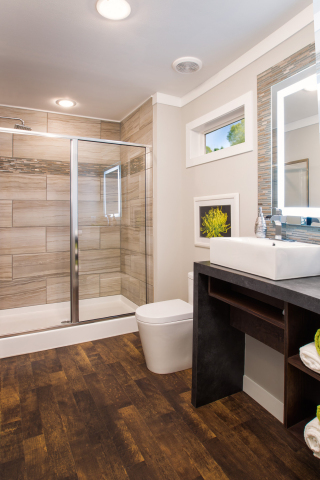 A backlit mirror and waterfall shower head turn our reinvented Refresh space into your own personal spa. (Photo: Clayton Homes)