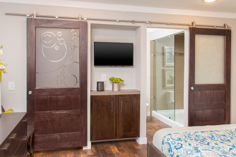 Sliding barn doors maximize space and provide a multifunctional design element. (Photo: Clayton Homes)