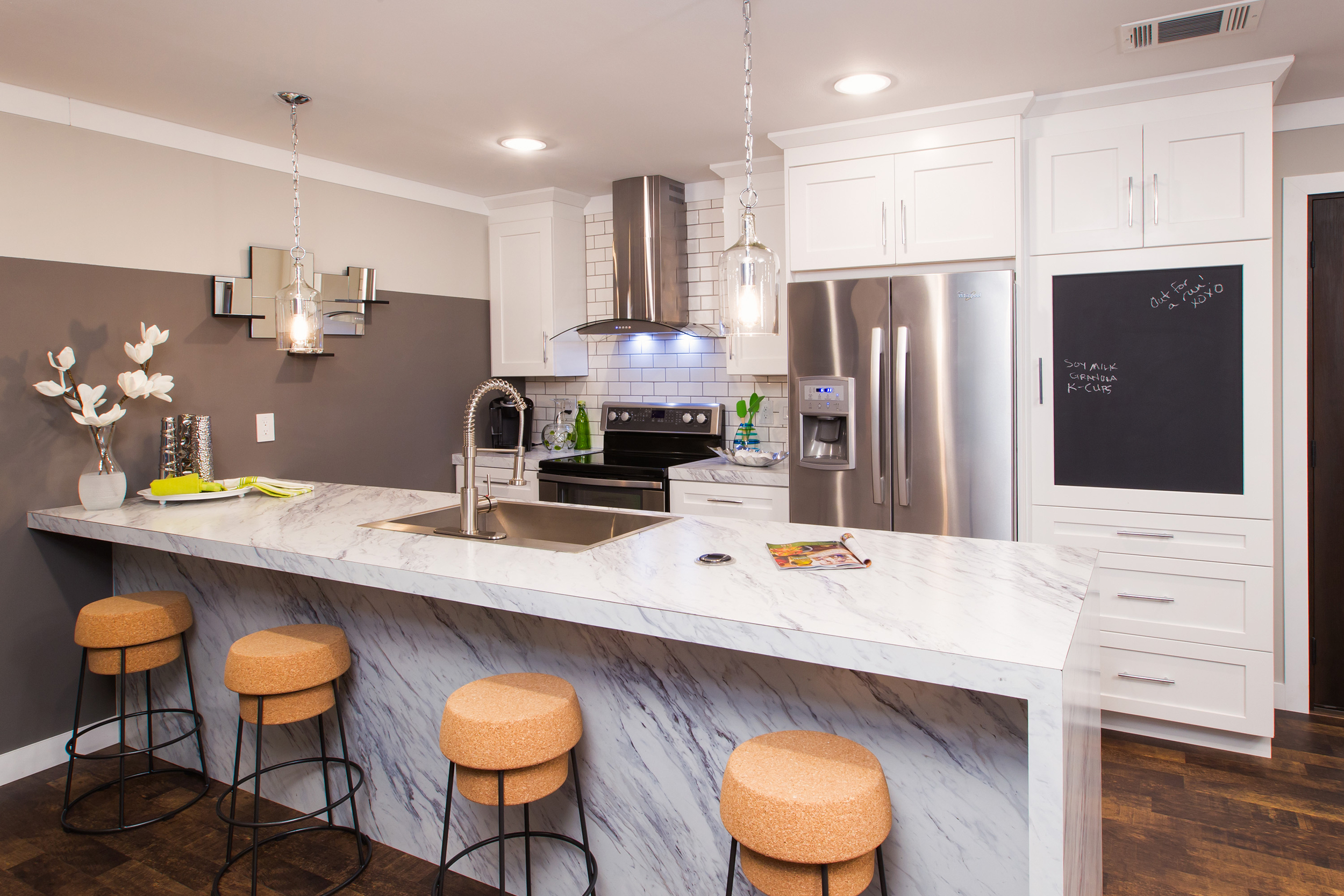 Embrace modern functionality and design in the centrally-located Cook area that includes a flexible prep space, built-in knife block and a pull-up outlet. (Photo: Clayton Homes)