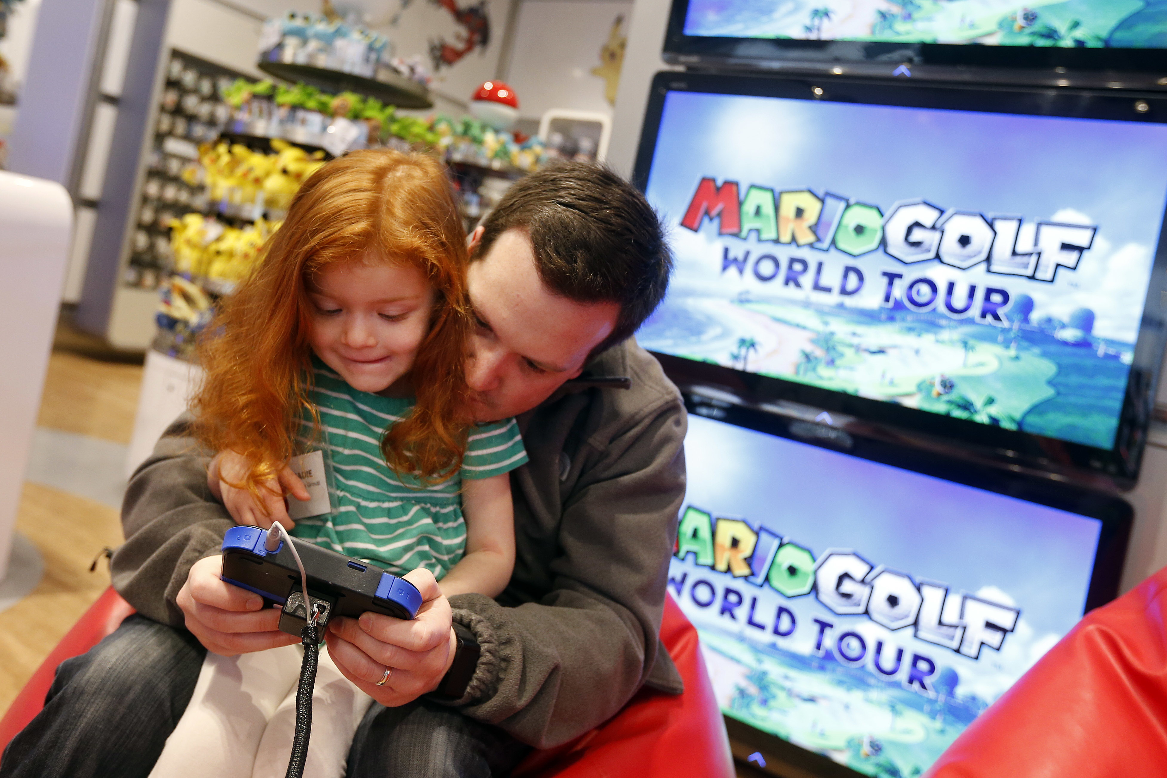 In this photo provided by Nintendo of America, kids attend an exclusive media event at Nintendo World on Saturday, April 26, 2014, in New York, to play new games like Kirby: Triple Deluxe, Mario Golf: World Tour and Tomodachi Life for the portable Nintendo 2DS hand-held system. Nintendo 2DS is the perfect entry point into the Nintendo hand-held experience and maintains many of the same hardware features as Nintendo 3DS. (Photo by Jason DeCrow/Invision for Nintendo/AP Images)