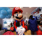 In this photo provided by Nintendo of America, Namira A., of Brooklyn, meets Mario at an exclusive media event at Nintendo World on Saturday, April 26, 2014, in New York. Attendees had the opportunity to meet characters and play new games, such as Mario Golf: World Tour, Kirby: Triple Deluxe and Tomodachi Life, for the portable Nintendo 2DS hand-held system. Nintendo 2DS is the perfect entry point into the Nintendo hand-held experience and maintains many of the same hardware features as Nintendo 3DS. (Photo by Jason DeCrow/Invision for Nintendo/AP Images)
