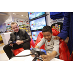 In this photo provided by Nintendo of America, Daniel C., right, of New York, meets celebrity and golf fan Noah Munck during an exclusive media event at Nintendo World on Saturday, April 26, 2014, in New York, where they play against one another in Mario Golf: World Tour for Nintendo 2DS and Nintendo 3DS. Mario Golf: World Tour changes the way golf is played with friends. Instead of waiting to take their turns, up to four players can play through courses simultaneously in local wireless or online matches. (Photo by Jason DeCrow/Invision for Nintendo/AP Images)