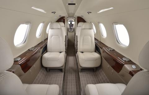 NetJets Signature Series Phenom 300 interior (Photo: Business Wire)