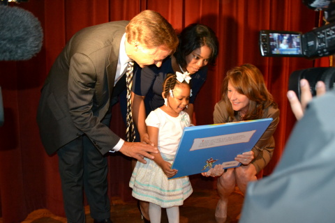 Tennessee Governor Bill Haslam and First Lady Crissy Haslam present 'The Little Engine that Could,' the 20 millionth book of Tennessee's Imagination Library to 3-year-old Tamera Tynes and her mother Cierra Tynes, at the program's tenth anniversary celebration in Memphis. (Photo: Business Wire)