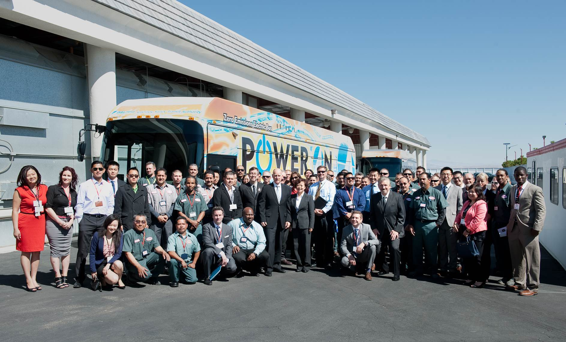 California Governor Jerry Brown stands with the American employees of BYD Motors at the April 2014 Unveiling Ceremony of the First American-Made, Long-Range, Electric Bus. (Photo: Business Wire)