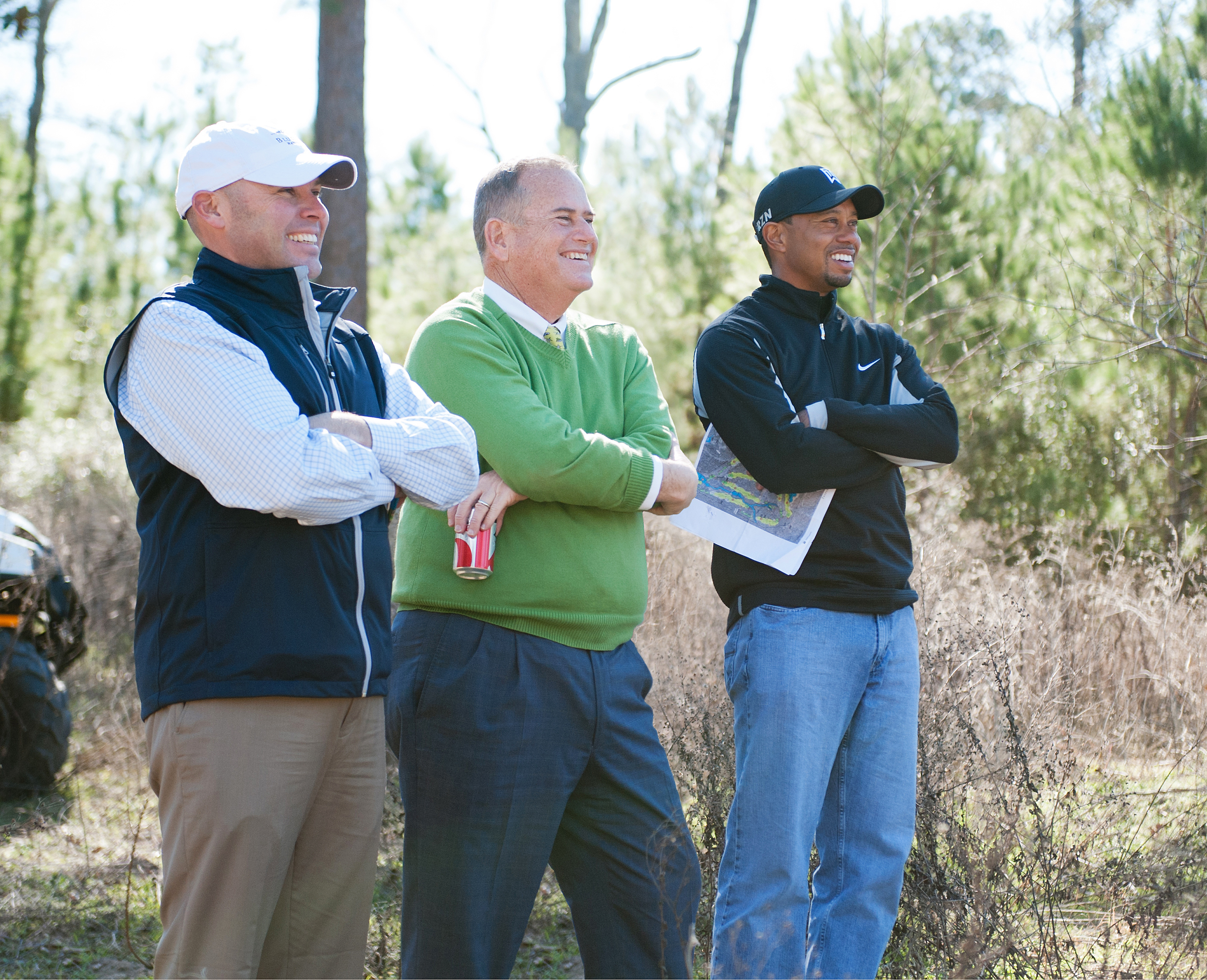 Tiger Woods to Design Golf Course at Bluejack National in Texas. (L to R) Beacon Land Development partners Casey Paulson and Michael Abbott meet with Tiger Woods during a site visit of Bluejack National's future golf course. (Photo: Business Wire)