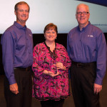 Steve Nieman, senior vice president of Tyler's Local Government Division, and Brett Cate, president of Tyler's Local Government Division, present a Tyler Excellence Award to Ridgeland's Deputy Director of Finance and Information Services Ina Byrd. (Photo: Business Wire)
