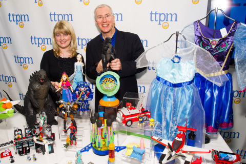 Laurie Leahey (L), senior editor of TTPM, and Chris Byrne, content director aka The Toy Guy®, appear with a selection of toys named to the 2014 TTPM Summer Play List, a round-up of the season's most fun and engaging products for children. The list was announced during the annual Spring Showcase press event on May 1, 2014 in NYC, hosted by TTPM, a consumer website publishing reviews, videos, and live price updates for all things play. (Photo: Business Wire)