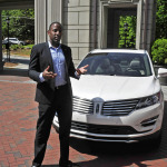 "Jeff Reid, Lincoln MKC brand manager, leads a discussion of the all-new 2015 Lincoln MKC small premium utility on Thursday, May 1, at the Mandarin Oriental Atlanta. The program was part of Lincoln's five-city ""Engage Your Senses"" tour. Photo credit: Getty Images for Lincoln Motor Company"