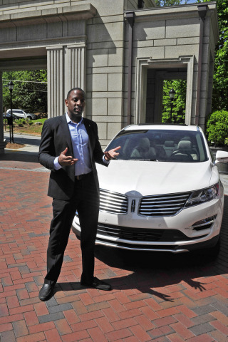 """Jeff Reid, Lincoln MKC brand manager, leads a discussion of the all-new 2015 Lincoln MKC small premium utility on Thursday, May 1, at the Mandarin Oriental Atlanta. The program was part of Lincoln's five-city """"Engage Your Senses"""" tour. Photo credit: Getty Images for Lincoln Motor Company"""