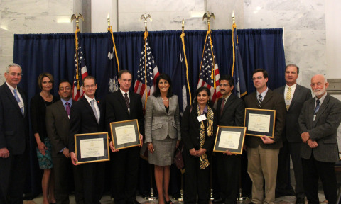 Governor Nikki Haley (center), SCRA CEO Bill Mahoney (left) and other attendees join award winners d ...