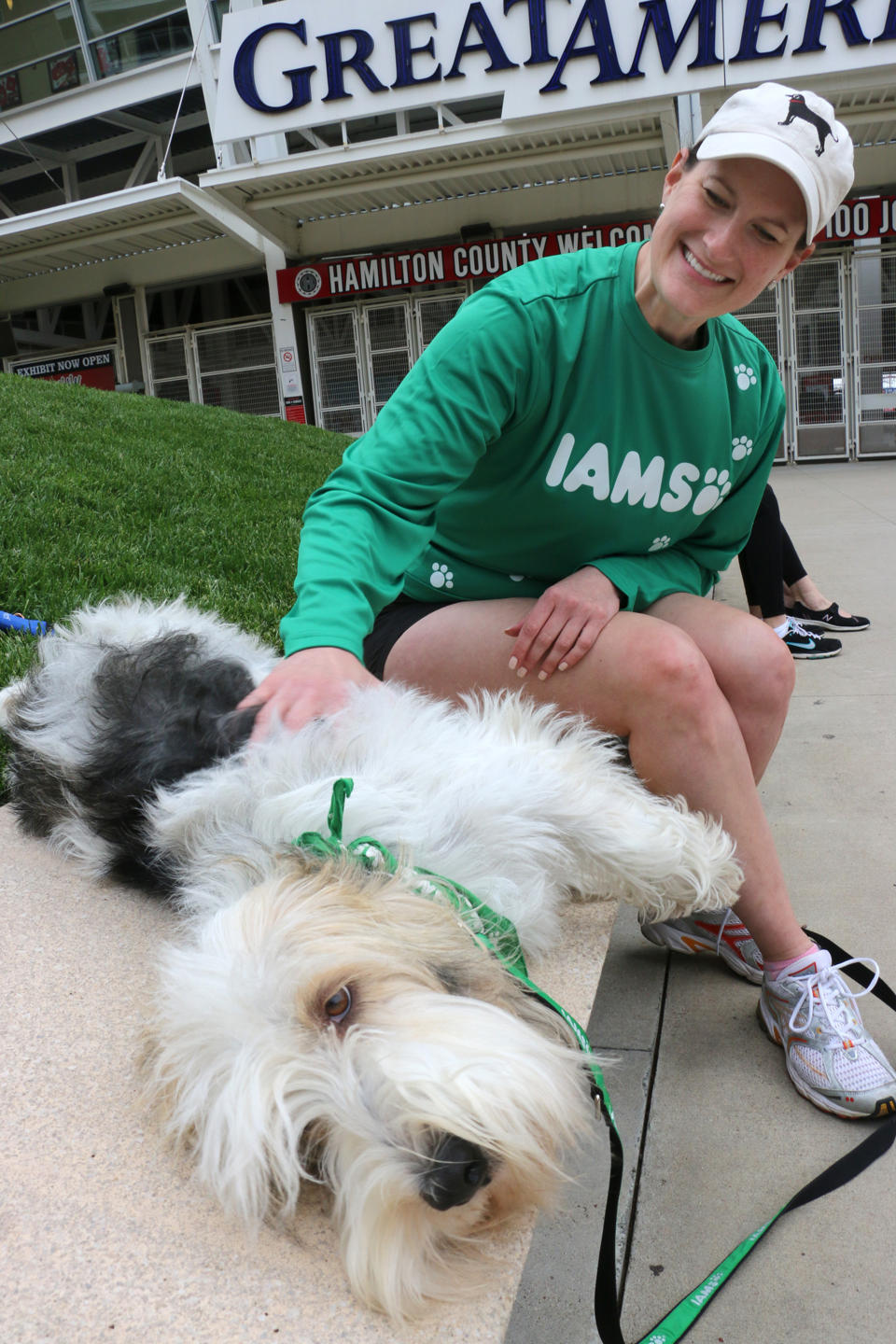 Meredith Leslie, of P&G, pets Pawl Griffin, IAMS VP of Canine Communications, as they get ready to run the IAMS Flying Fur dog run in downtown Cincinnati, Sat., May 3, 2014. More than 500 dogs and owners ran in the two-mile race as part of races taking place during the Flying Pig Marathon weekend events. IAMS Bowls of Love will be donating a bag of pet food for each dog running in the event to the SPCA in Cincinnati. (Tom Uhlman/AP Images for IAMS)
