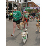 Meredith Leslie, of P&G, runs with Pawl Griffin, IAMS VP of Canine Communications, during the IAMS Flying Fur dog run in downtown Cincinnati, Sat., May 3, 2014. More than 500 dogs and owners ran in the two-mile race as part of races taking place during the Flying Pig Marathon weekend events. IAMS Bowls of Love will be donating a bag of pet food for each dog running in the event to the SPCA in Cincinnati. (Tom Uhlman/AP Images for IAMS)