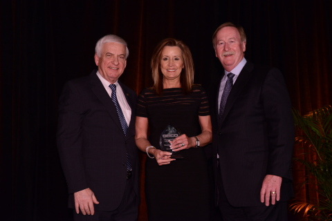 Sandra Perkins is congratulated by GEICO Chairman and CEO Tony Nicely (left) and GEICO president and COO Bill Roberts after being named GEICO new field representative of the year. (Photo: Business Wire)