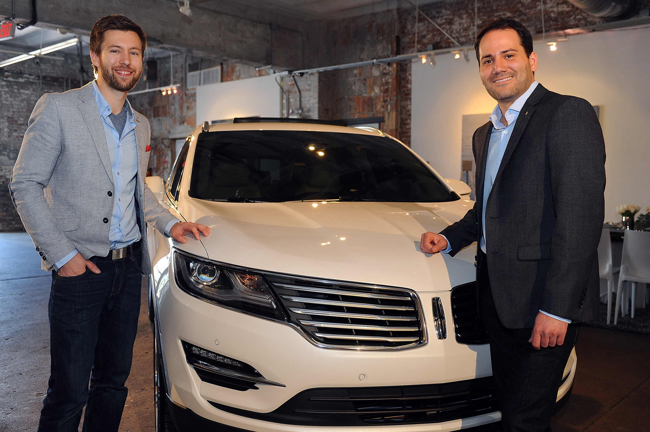 The 2015 Lincoln MKC, the brand's first small premium utility, is engaging the senses through a tour of cities this spring. On Monday, May 5, Dillon Blanski (left), Lincoln MKC exterior designer, and Antonio Molinari, Lincoln MKC interior designer, discussed progressive, classic design with a modern twist during a luncheon at Long View Gallery in Washington, D.C. Photo credit: Getty Images for The Lincoln Motor Company.