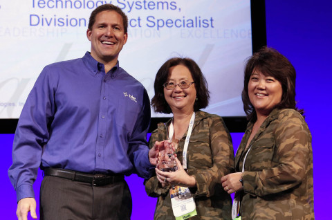 Chris Hepburn, senior vice president of Tyler's ERP & School Division, presents a Tyler Excellence Award to Choy Wong and Kelly Laidley of Contra Costa County Office of Education's Technical Services department. (Photo: Business Wire)