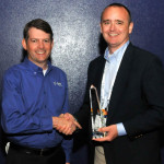 Asotin County Public Utility District's Treasurer Bob Sischo accepts a Tyler Excellence Award from Jeff Green, senior vice president at Tyler. (Photo: Business Wire)