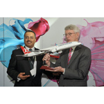 Mr. Ahmet Bolat, Chief Investment and Technology Officer at Turkish Airlines, presents Thomas P. Glynn, CEO of Massachusetts Port Authority, with a Turkish Airlines airplane model to celebrate the launch of the airlines' sixth U.S. gateway at Boston Logan International Airport. (Photo: Business Wire)