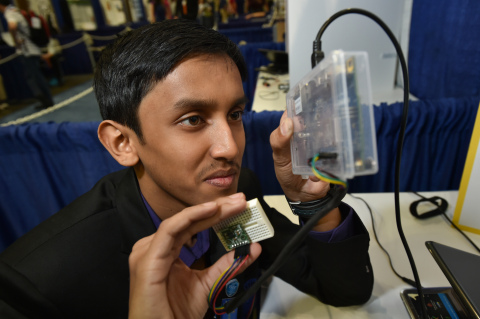 """Amrit Sahu, 14, of India presents his """"Voice-o-nator,"""" an Intel(R) Galileo-based device that enables ..."""